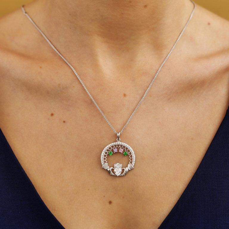 four stone family claddagh pendant on model