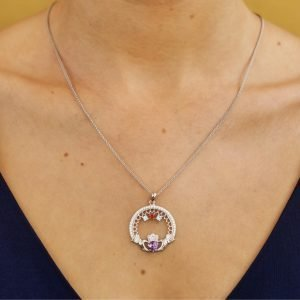 three stone family claddagh pendant on model