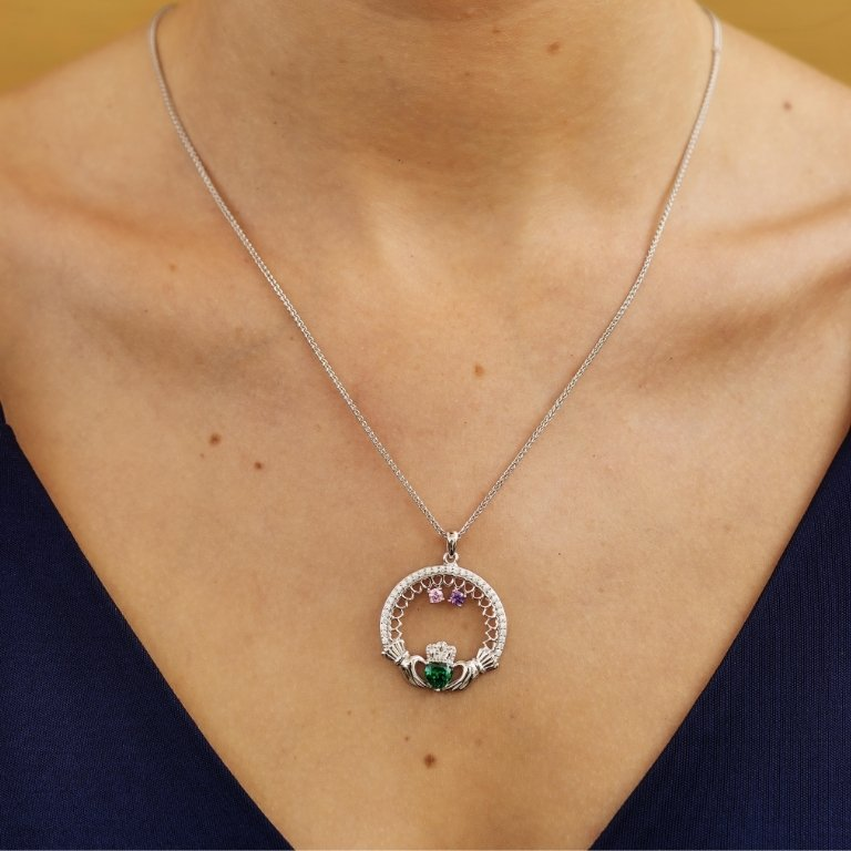 two stone family claddagh pendant on model