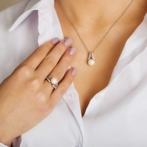 Sterling Silver Pearl Trinity Knot Pendant on Model