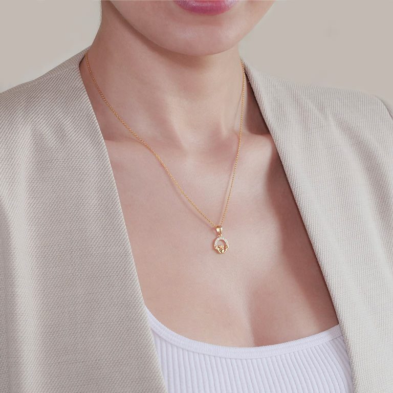14KT Gold Vermeil Claddagh Necklace Studded with White Cubic Zirconias On Model