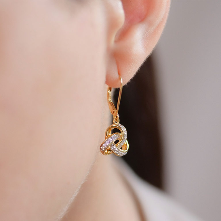 14KT Gold Vermeil Drop Celtic Knot Earring Studded With White Cubic Zirconias On Model