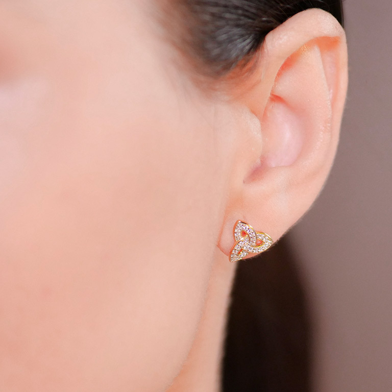 14KT Gold Vermeil Stud Trinity Knot Earrings Adorned with White Cubic Zirconias On Model