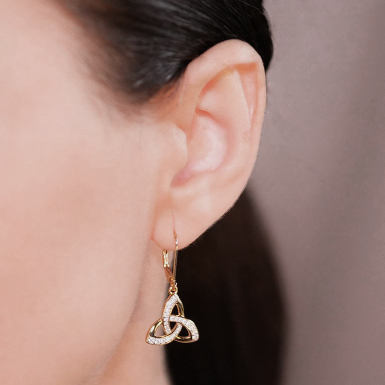 14KT Gold Vermeil Drop Trinity Knot Earrings Studded with White Cubic Zirconias On Model