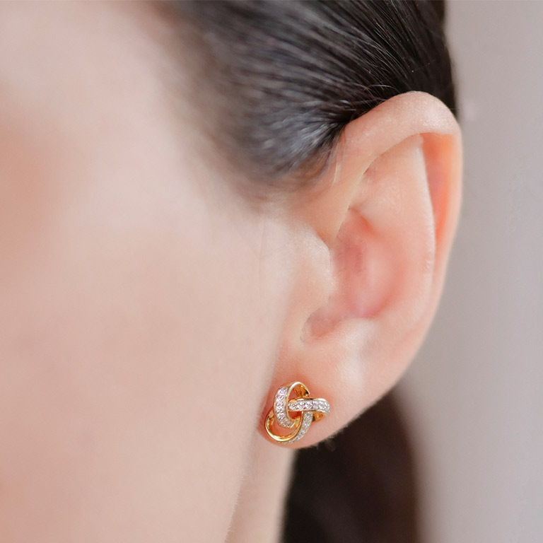 14KT Gold Vermeil Stud Celtic Knot Earrings Adorned with White Cubic Zirconias On Model