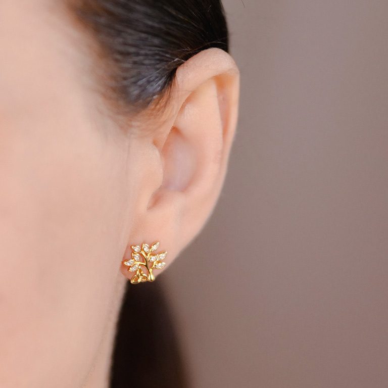 14KT Gold Vermeil Stud Celtic Tree of Life Earrings Adorned with White Cubic Zirconias On Model