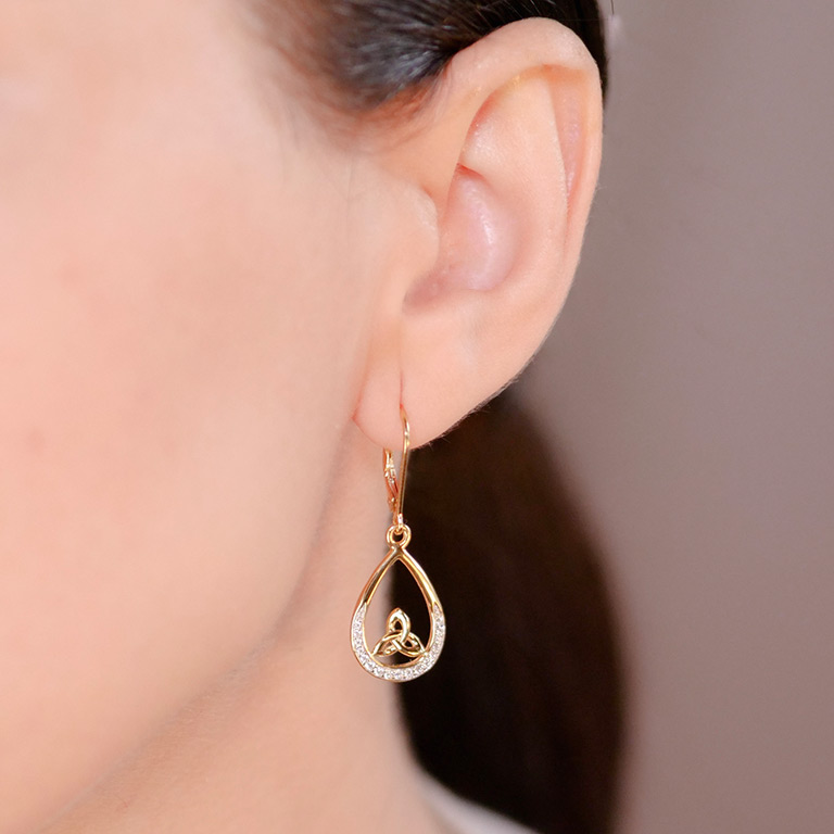 14KT Gold Vermeil Tear Drop Trinity Knot Earrings Studded with White Cubic Zirconias On Model