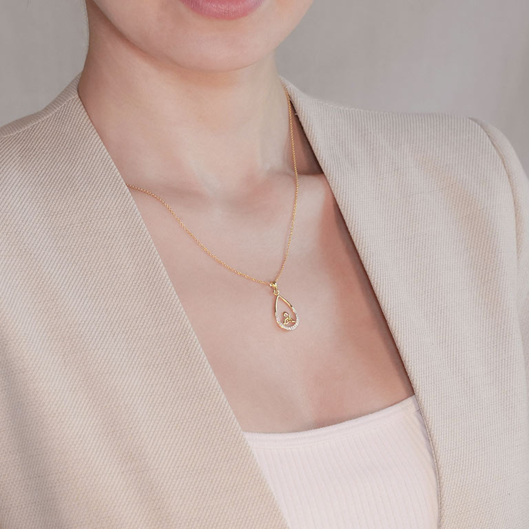 14KT Gold Vermeil Tear Drop Trinity Knot Pendant Studded With Cubic Zirconias On Model