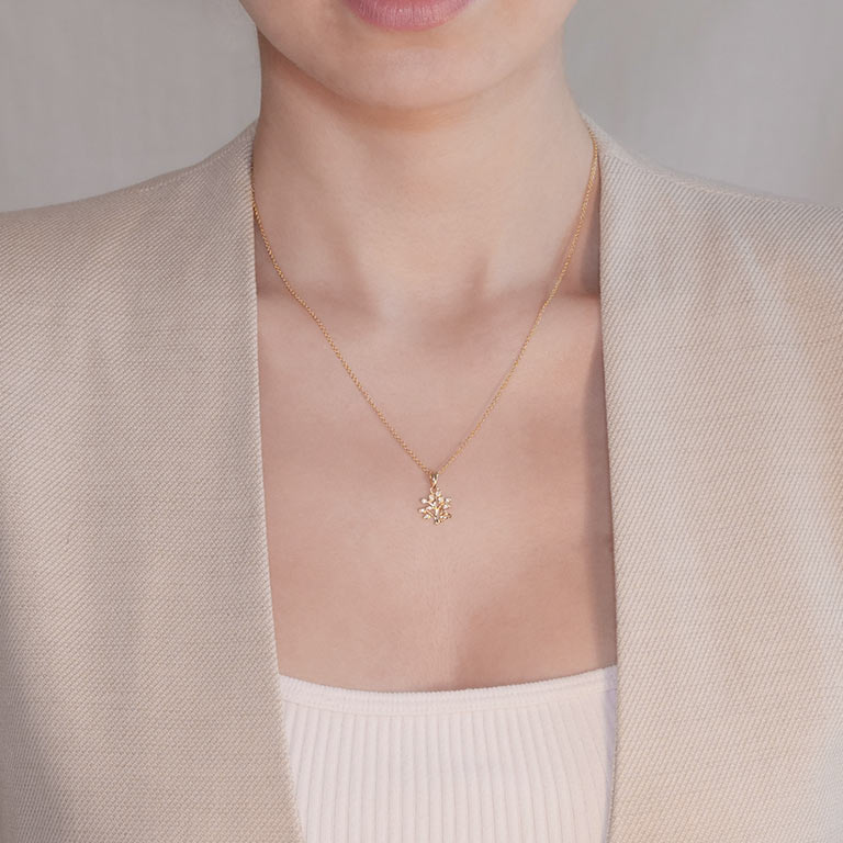 14KT Gold Vermeil Tree of Life Necklace Adorned with White Cubic Zirconias On Model