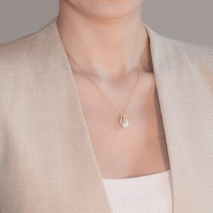 14KT Gold Vermeil Trinity Knot Pearl Pendant Studded with White Cubic Zirconias On Model