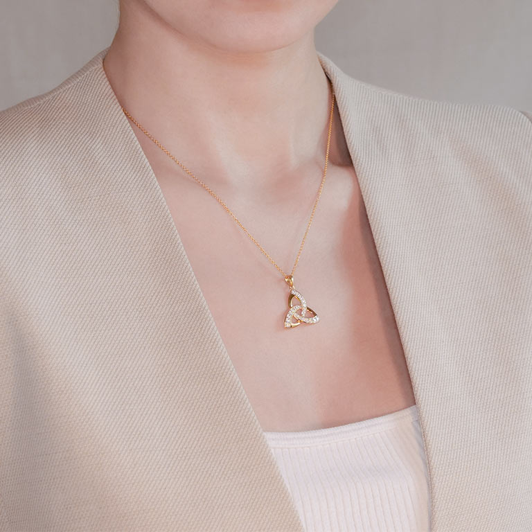 14KT Gold Vermeil Trinity Knot Pendant Studded with White Cubic Zirconias On Model